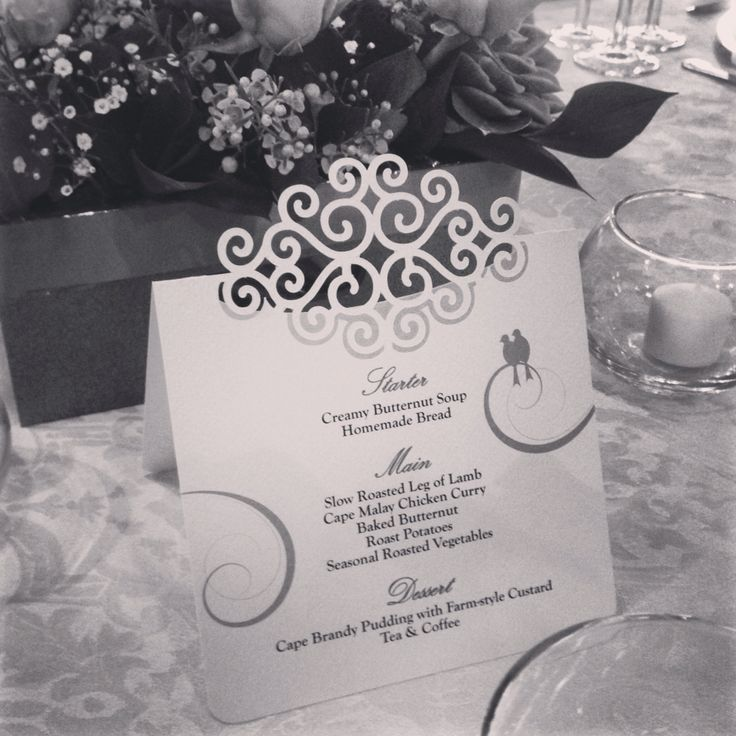 Wedding menu with swirl cutout and printed swallows. Simple and elegant. Made by www.poppyseedcollective.com