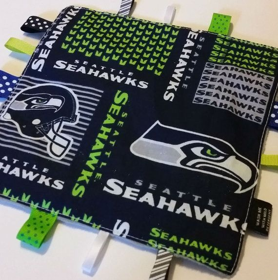 Seattle Sehawks themed sensory toy with Sehawks fabric on the front and cuddly Seahawks green or gray minky on the back. Description from etsy.com. I searched for this on bing.com/images