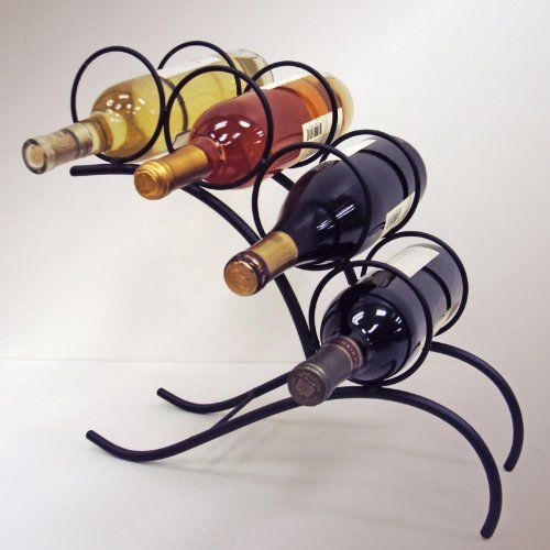 """J&J Wire 4-Bottle Wine Rack by J&J Wire. $42.40. Durable wrought iron construction. Highest quality black powder-coat finish. Made in the USA. Dimensions are 15""""l x 5""""w x 15""""h. Holds four bottles of wine. Add character to any setting with this four bottle holder. store your wine in this unique design made of sturdy wrought iron that has been cured under heat to produce a durable black powder-coat finish. welded fabrication means that no assembly is required. this..."""