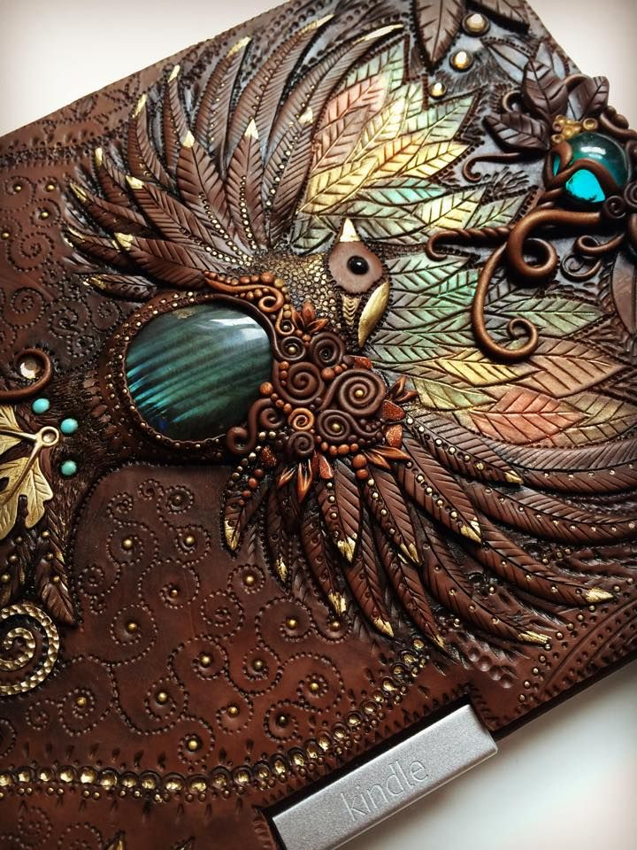 Handcrafted Fairytale Clay Journals by Mandarin Duck Jewelry designer Aniko Kolesnikova (previously featured here) best known as Mandarin Duck is recognized for her whimsical sophisticated ornate work featuring mystical and exotic creatures such as owls and dragons as well as other natural elements like floral aesthetics. An expert at working with polymer clay Mandarin Duck on YouTube was created for the purpose to teach people how to make beautiful handmade things. Now also a book…