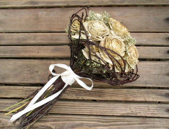This simple elegant dried rose bouquet is a symbol of undying love and beauty in everlasting cedar roses accented with babys breath and surrounded by a nest of birch twigs. You can customize this bouquet in a combination of satin ribbon in a choice of colors, up-cycled burlap, and sisal twine. I will include a personal message in a blank seasonal card for gift shipments. Just let me know what you would like your message to say in notes to seller at check out. Measures approximately 14 tall…