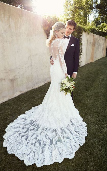 This designer fit-and-flare wedding dress from the Essense of Australia collection is made from beautiful, vintage-inspired Lace over rich Dolce Satin and features a timeless illusion neckline, back, and sleeves. The back zips up under fabric-covered buttons. Tall, short, or full-figured, this fashion-forward silhouette is ideal for any bride who wants to accentuate her sexy, hourglass figure.