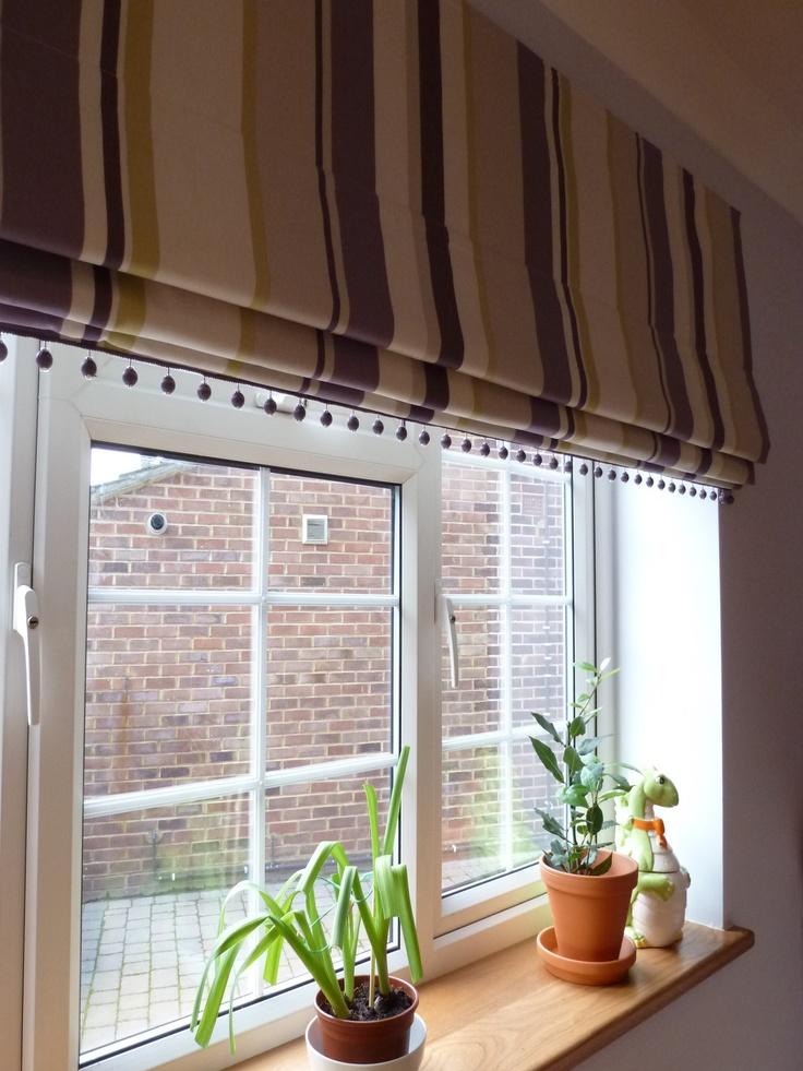 a lovely stripe blackout roman blind finished with