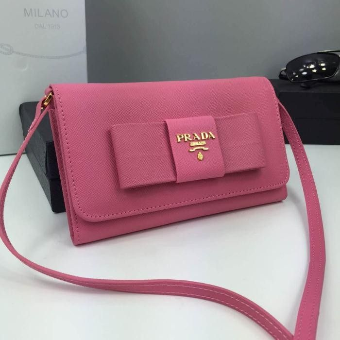 Thousands of ideas about Prada 1M1437 Large Bow Saffiano Leather ...