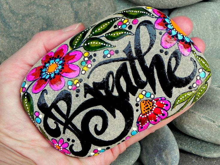 Painted stones throughout the gardens    Breathe...peaceful energy tumbled in on ocean waves.../ Painted Sea Stone / Sandi Pike Foundas / Cape Cod.