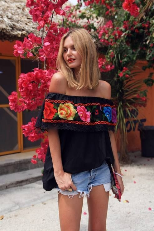 Shop this look on Lookastic:  http://lookastic.com/women/looks/black-embroidered-peasant-blouse-light-blue-denim-shorts-multi-colored-embroidered-clutch/11226  — Black Embroidered Peasant Blouse  — Light Blue Denim Shorts  — Multi colored Embroidered Clutch