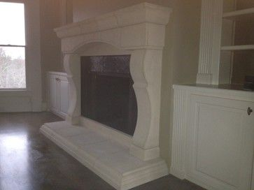 CAST STONE FIREPLACE MANTELS - mediterranean - with built in side book shelves.