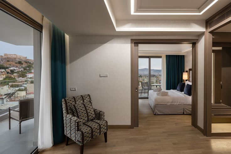 Acropolis Suites offer balcony with spectacular views of the Acropolis, white marble bathrooms, coffee machine, hardwood/parquet floors and 48'' Samsung Smart TV Led.