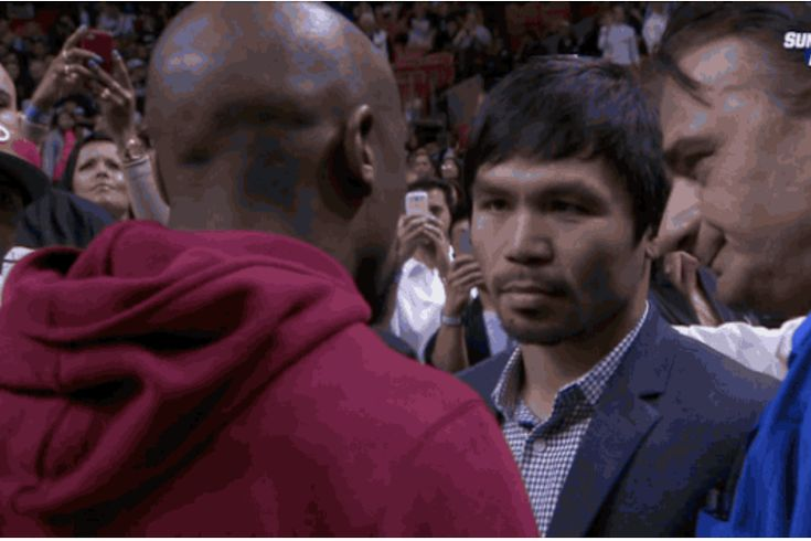 Floyd Mayweather  and Manny Pacquiao are rumored to be in talks for a fight in 2015, per  Yahoo's Kevin Iole , and both of them sitting courtside at Tuesday's game between the Miami Heat and Milwaukee Bucks will only add fuel to the fire...