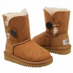 Ugg Bailey Button Toddler Boot in Chestnut - The kids UGG® Bailey Button is a playful twist on the Kids Classic Boot. Featuring a wooden UGG® logo button and genuine Twinface sheepskin, this boot is comfortable and adorable. #uggs