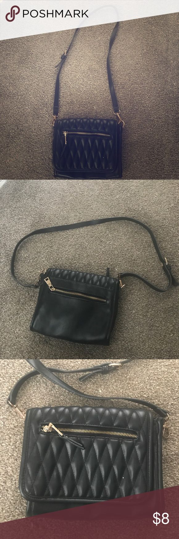 Black crossover purse Black crossover purse with gold zipper and details Bags