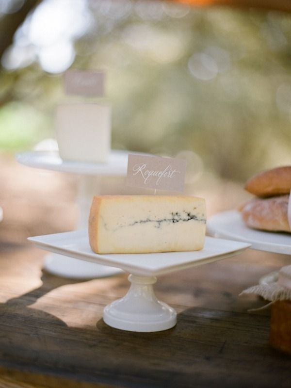 Calligraphy labeled cheese on white platters for our French countryside inspired school