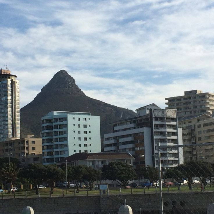 Signal Hill peaking out behind the high rise buildings of Sea Point
