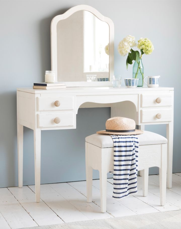Loaf's white wooden dressing table with comfy padded stool, natural wooden handles and a mirror. Plus there are four lovely drawers for storing lotions and potions. Mirror, mirrors, wall mirror, floor mirror, mirror homewares, interior, design, furniture, accessories, wall decor, round mirror, oval mirror, shelf mirror, storage mirror