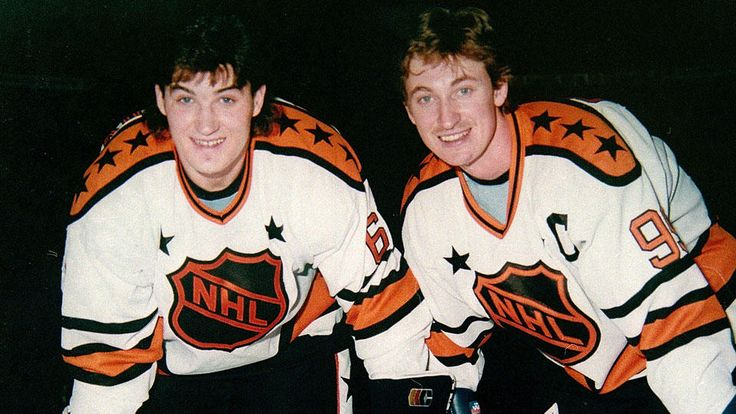 """""""NHL legends Mario Lemieux and Wayne Gretzky pose for a photo in Montreal in the 1980's. Lemieux's 168-point campaign in 1987-88 broke Gretzky's hold on the Hart and Art Ross trophies. Gretzky had previously won the Hart eight consecutive years and the Art Ross seven straight times."""" (Photo by Denis Brodeur/NHLI via Getty Images)"""