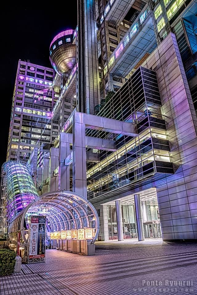 AWESOME ARCHITECTURE - The Fuji Television building in Odaiba, Tokyo with its beautiful illuminations at night in Japan.