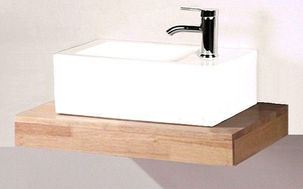 We willen dit fonteintje: het plankje van hetzelfde hout wat ook in de keuken terugkomt.