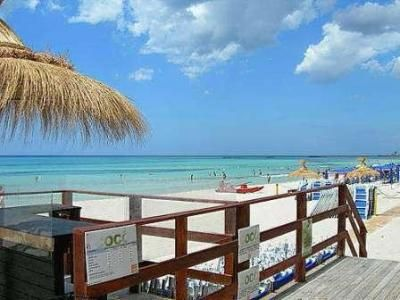 Beach and boardwalk in Salento Italy.