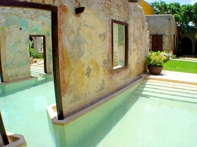 I love the way they incorporated the ruined walls of the old Hacienda into the pool design.  This is in the Yucatan, Mexico
