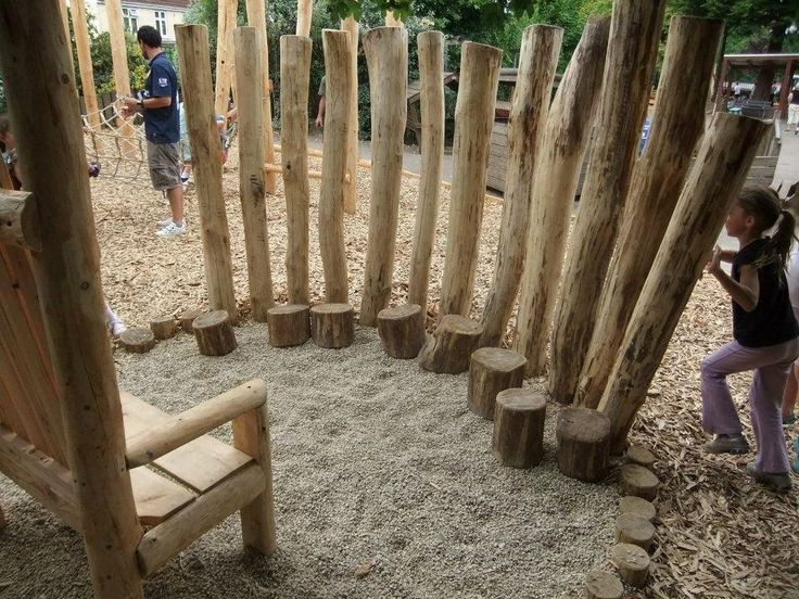 Small Logs are used as seats with the tall chestnut timbers making the space small and enclosed.