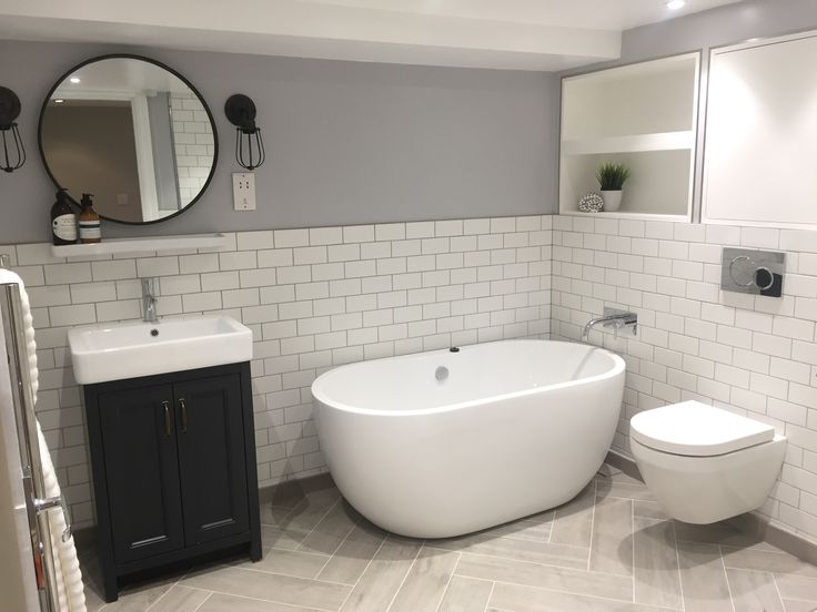 Bathroom for Vauxhall apartment.  Pleased with wood effect floor tiles.  white subway tile
