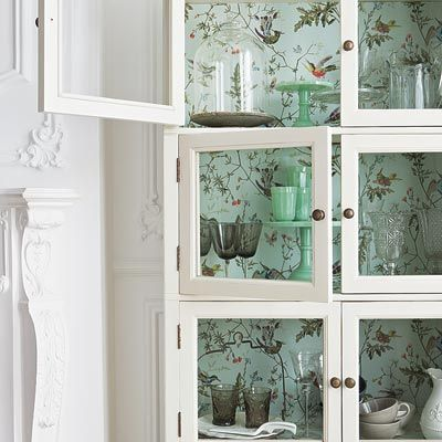 Paper inside a glass-front cabinet or open shelving adds an inviting depth as it highlights the contents. |   Photo: Jon Day/IPC Images | thisoldhouse.com