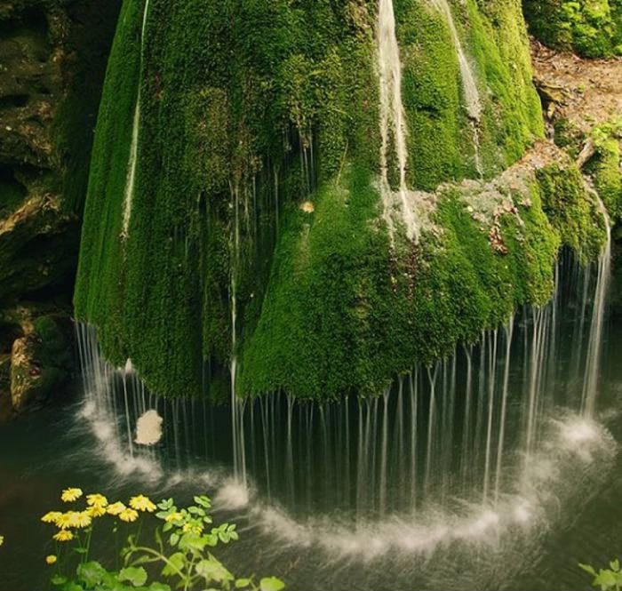 Waterfall in Transylvania, Romania wow this is one of those sights I actually am just struck with the need to see irl. ONE DAY I WILL TRAVEL ALL EUROPE (but in comfort, I'm sorry backpacking is not for me, especially after that Taken stuff...paranoia)