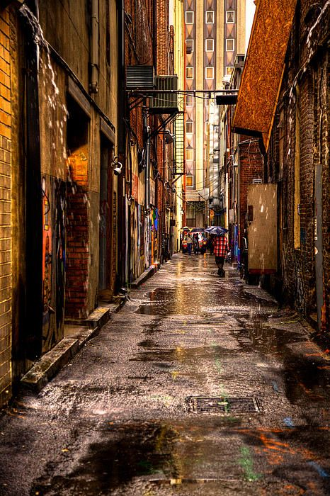 Market Square Alleyway - Knoxville Tennessee  I know it's an ally, but I love the wet pavement and the colors in the buildings