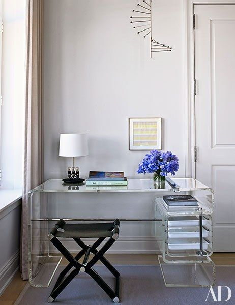 A circa-1956 Poul Kjærholm candelabra is suspended above the master suite's vintage Rena Dumas desk | archdigest.com