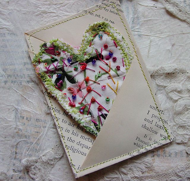 Woven strips of vintage fabric with embroidery in a paper pocket - what a pretty presentation
