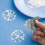 snowflake painting using pine needle branch via Family Fun. Pinned by Muddy Monkeys.