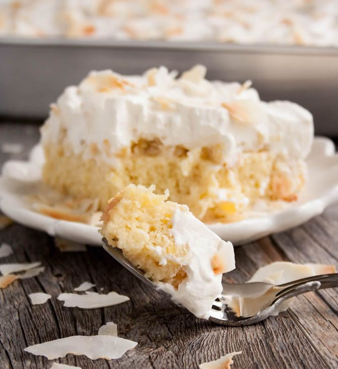 Pineapple Coconut Tres Leches Cake. A twist on the classic made with coconut milk, a layer of crushed pineapple and topped with toasted coconut!