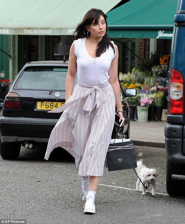 Stylish lady: Daisy Lowe, 27, once again showed off her sartorial prowess as she walked her pet pooch in Primrose Hill on Friday…