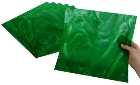 """Emerald Moire - Made in the USA, translucent, easily cut with scissors, perfect for scoring, folding, embossing and die cutting! Stunningly brilliant optical effects! Add instant pizzazz to craft projects, seasonal accents, party decorations, scrapbooks, greeting cards, jewelry, furniture, frames, gifts, favors, accessories, art and DIY home decor projects. To instantly add """"POP"""" and """"WOW"""" to your projects, just add Rowlux!"""