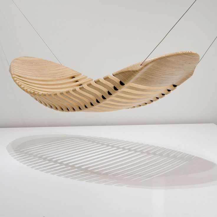 The Wooden Hammock - designed as an alternative to the common cloth hammock. Although made from wood, the design is flexible and comfortable due to rubber vertebra which allow the wooden segments to move, mimicking the human spine.