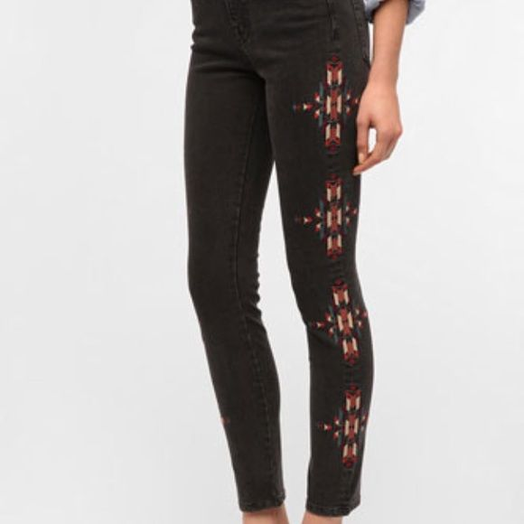 BDG Embroidered Jean Embroidered Jean from Urban Outfitters. The pants are a washed grey with an embroidered tribal design down the side of the leg. Urban Outfitters Jeans