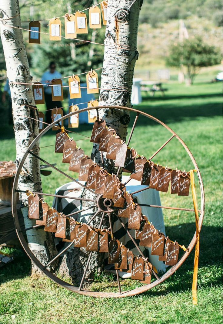 This seating card display is perfect at this rustic ranch wedding!