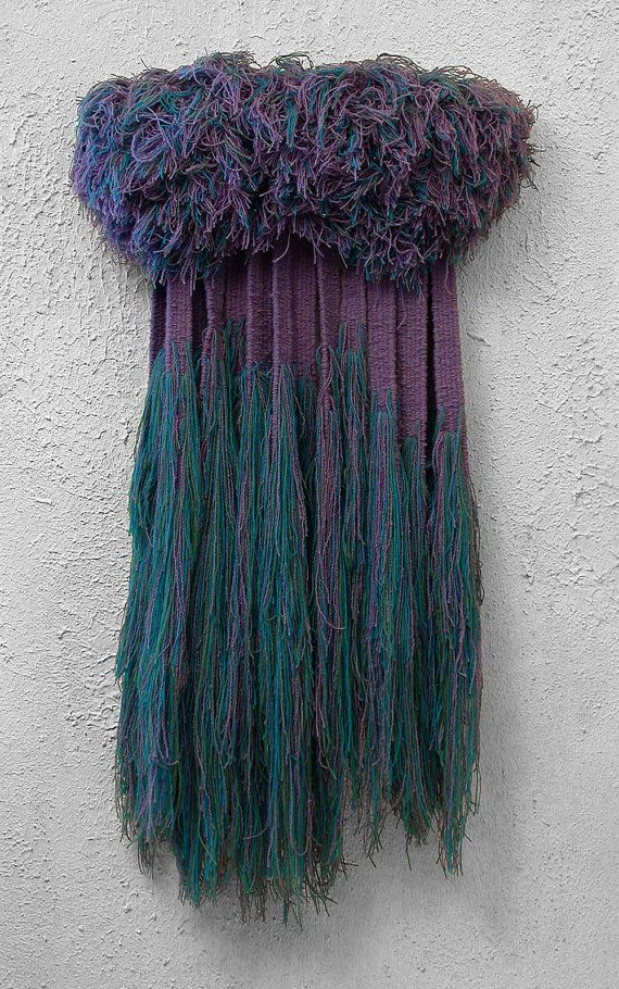 "Entitled ""Bayou"" this soft fiber wall sculpture hangs rich with the mossy blues of a deep purple cypress twilight."