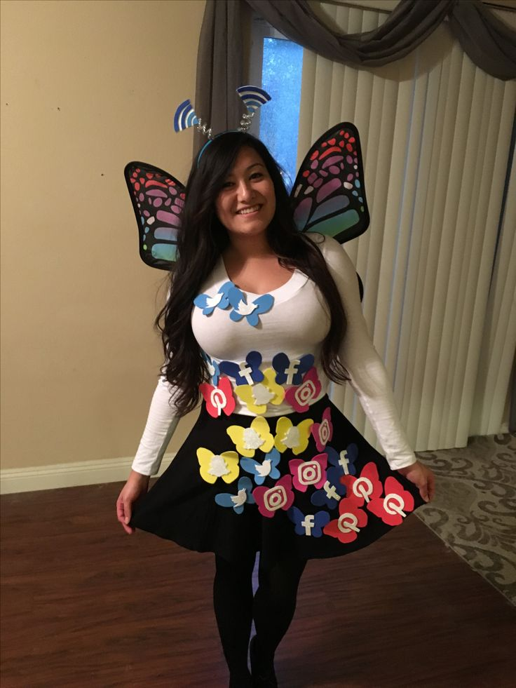 My Social Butterfly Halloween costume. I cut out all of the butterflies and social media logos out of styrofoam craft paper. I hot glued the logos onto the butterflies and then hot glued the completed butterflies onto my shirt and skirt. My antennas are wifi signals also cut out from styrofoam craft paper. I attached them to a headband using hot glue and silver pipe cleaners. The top is just an all white long sleeve v-neck from Ross and I bought the black skater skirt onsale from Kohl's.