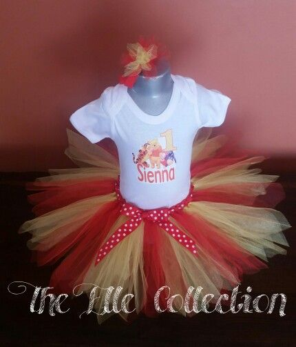 Winnie the Pooh red and yellow tutu skirt and personalized shirt with matching headband custom made by the Elle Collection in South Africa.  To order email Karin on theellecollection13@gmail.com