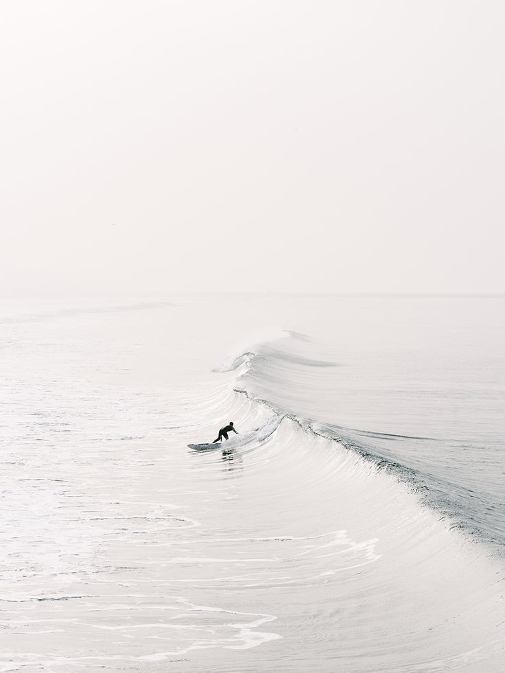 lonely surfer taking the first wave of the day