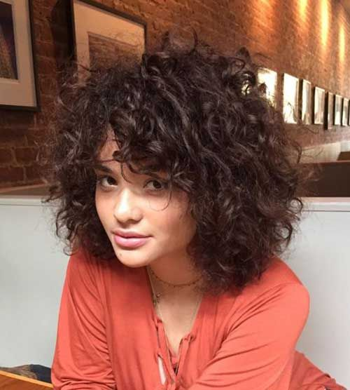 20 Curly Short Hairstyles for Pretty Ladies: #1. Thick Short Curly Hair