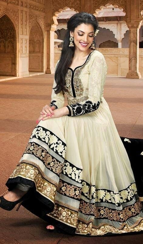 Pakistani Fashion - If I had such a graceful and demure dress, I would go back to wearing white.