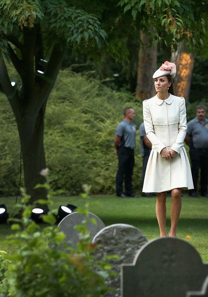 Catherine, Duchess of Cambridge looks at war graves at St Symphorien Military Cemetery on August 4, 2014 in Mons, Belgium.