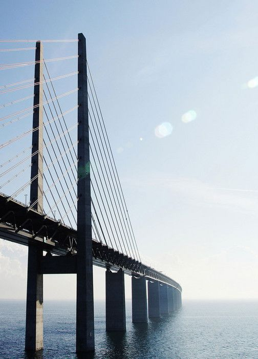 Take a train over the Oresund Bridge, between Malmo and Copenhagen