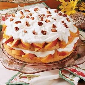 """Peach Shortcake Recipe -With blushing fresh peaches in plentiful supply, Karen Owen of Rising Sun, Indiana thinks this appealing layered dessert can't be beat. """"Brown sugar and ginger give the shortcake its mellow, sweet-spicy flavor,"""" she notes."""