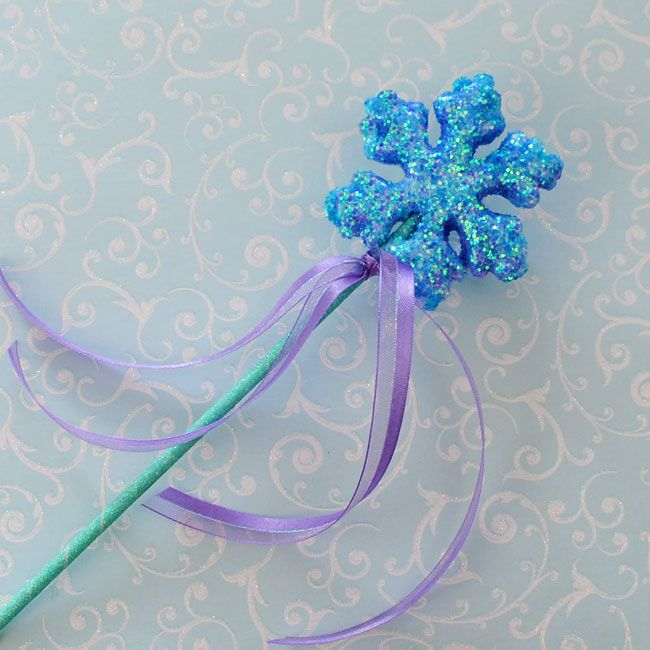 Snow wands -  Materials: Wilton 8 inch lollipop sticks Stryrofoam snowflake three inches or larger in diameter Glitter in your choice of color, aqua, blue, lavender or silver Glitter tape Elmer's glue or styrofoam glue 3/8 inch ribbon in purple, aqua or the color of your choice An awl or Phillips head screw driver (to punch a hole in the snowflake for the wand handle) optional: a small art paint brush to spread the glue