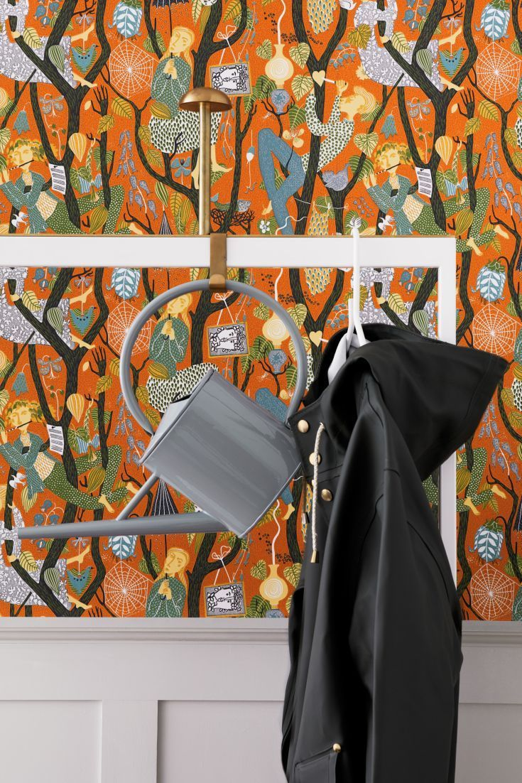 A quirky and unusual wallpaper design featuring trees, leaves, animals and people illustrated in a folksy style.
