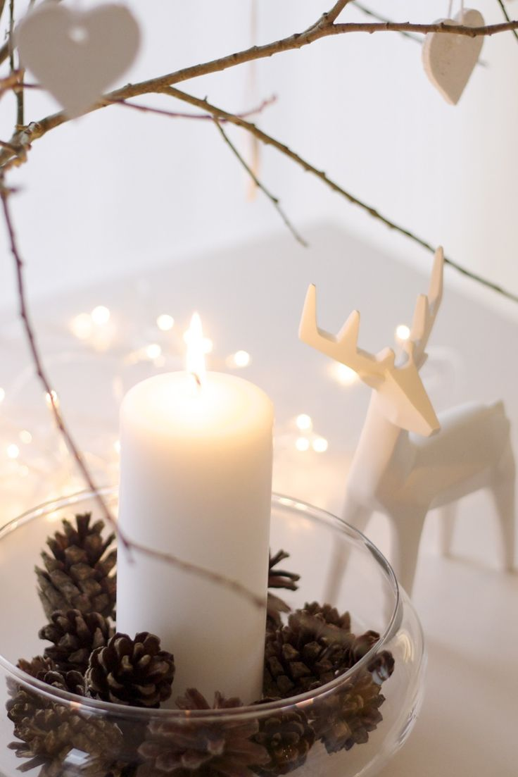 White ceramic and bare branches make simple, modern Christmas decoration ideas