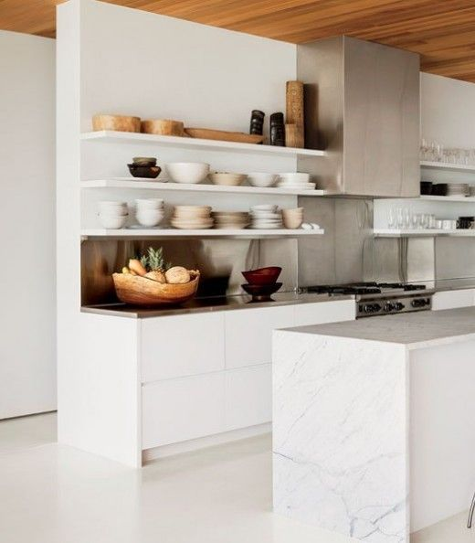 marble island, open shelving, stainless counters and backsplash
